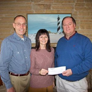 Mike Stone, Vice President of Southern Shores Realty, presenting a check to Kathy McCullough-Testa, Executive Director of the Beach Food Pantry, and Steve Hanson, Vice President of the Beach Food Pantry Board of Directors.  (PRNewsFoto/Southern Shores Realty)