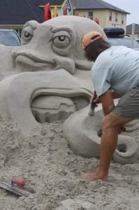 Sandsculptor at Work - Courtesy of Kitty Hawk Kites
