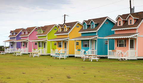 (Colorful, one bedroom cottages on the outskirts of Hatteras Village)