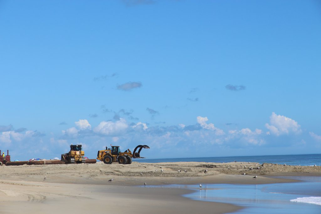 bulldozers working on the outer banks beach replenishment project